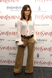 Gina Gerson rocked a '70s vibe with this ruffle-cuff button-down and flared pants combo at the 'Yves Saint Laurent' premiere.