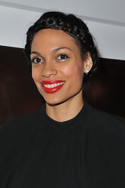 Rosario Dawson wore her long tresses in a shiny braided halo at the Yves Saint Laurent fall 2012 fashion show.