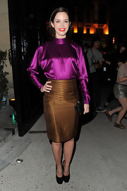 Emily Blunt chose a bright purple satin blouse for her colorful and chic look at Paris Fashion Week.