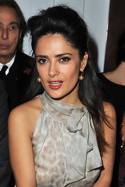Salma Hayek attended the Yves Saint Laurent fall 2012 ready-to-wear fashion show in Paris wearing her hair in a sexy voluminous half-up style.