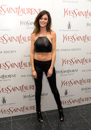 Nicole Trunfio vamped it up in a black leather crop-top during the 'Yves Saint Laurent' premiere.
