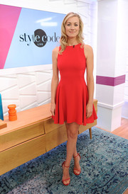 Yvonne Strahovski paired her cute dress with red skinny-strap heels.