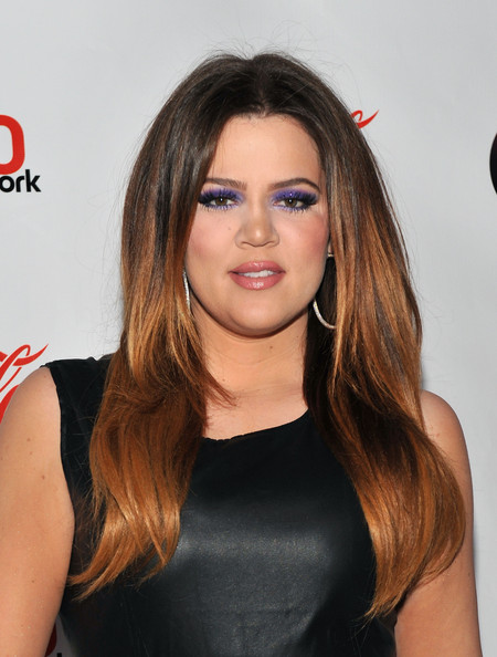 Khloe Kardashian wore ultra-bright violet glitter shadow and lengthy false lashes at the 2011 Jingle Ball.