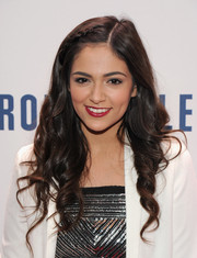 Bethany Mota looked adorable with her partially braided corkscrew curls during Jingle Ball.