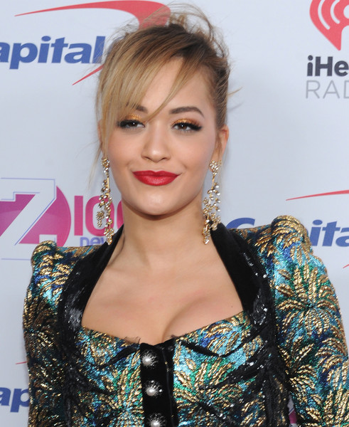 Rita Ora finished off her makeup with a bold red pout.