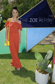 Cara Santana attended the ZOEasis event wearing a burnt-orange off-the-shoulder jumpsuit.