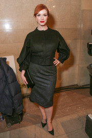 Christina Hendricks showed off a black Zac Posen cropped jacket with architectural-detailed sleeves during the label's fashion show.