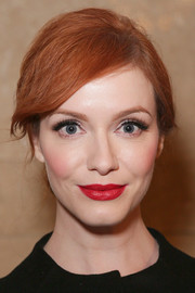 Christina Hendricks styled her trademark red hair into a casual chignon for the Zac Posen fashion show.