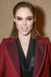 Coco Rocha wore her hair straight and gelled at the top and sides during the Zac Posen fashion show.