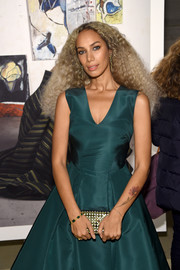 Leona Lewis accessorized with an elegant mirror-embellished clutch at the Zac Posen presentation.
