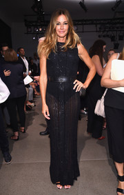 Kelly Bensimon brought some sex appeal to the Zac Posen fashion show with this sheer, sparkly maxi dress.