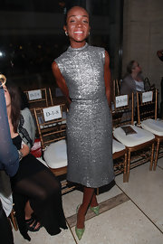 Genevieve Jones attended the Spring 2012 Zac Posen fashion show in green glitter pumps.