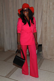 June Ambrose carried a basic leather shoulder bag at the Zac Posen spring fashion show.