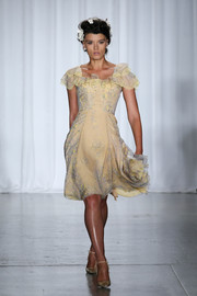 A pair of yellow satin pumps finished off Crystal Renn's catwalk look.