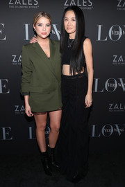 Ashley Benson teamed black platform boots with an army-green blazer for the Vera Wang Love holiday cocktail soiree.