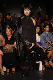 Jackie Cruz attended the Zang Toi fashion show looking sultry in a sheer black cold-shoulder blouse.