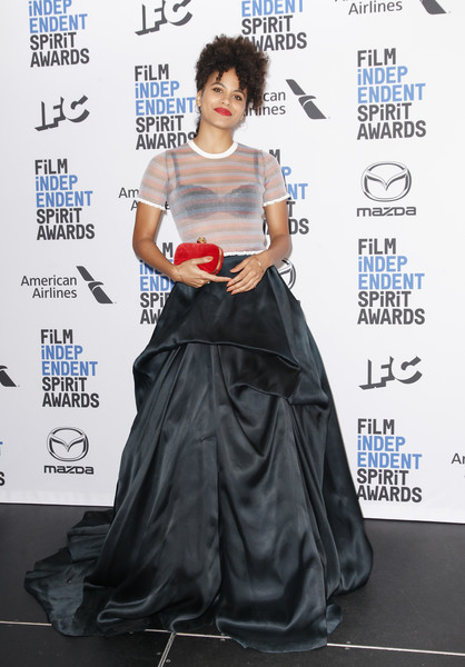 Zazie Beetz Sheer Top [clothing,dress,shoulder,carpet,gown,red carpet,hairstyle,flooring,lady,fashion,california,los angeles,the line hotel,film independent spirit awards nominations press conference,zazie beetz]