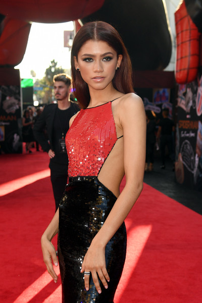 Zendaya Coleman Diamond Ring [red carpet,carpet,clothing,flooring,dress,premiere,shoulder,fashion,fashion model,leg,red carpet,zendaya,spider-man far from home,tcl chinese theatre,california,hollywood,sony pictures,premiere,premiere]
