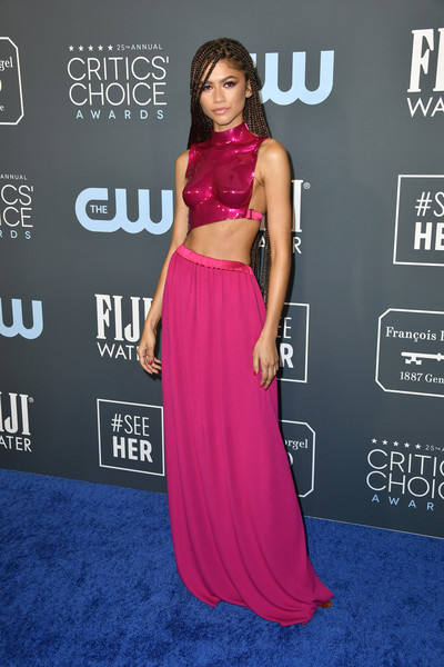 Zendaya Coleman Crop Top [clothing,shoulder,dress,red carpet,carpet,magenta,pink,premiere,hairstyle,joint,dress,zendaya,critics choice awards,red carpet,film awards,television,clothing,shoulder,academy awards,barker hangar,anne hathaway,24th critics choice awards,25th critics choice awards,red carpet,the barker hangar,critics choice movie awards,celebrity,film awards seasons,television,academy awards]