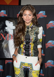Zendaya Coleman looked vibrant and smart in a printed button-down and matching pants during her CD and book release event.