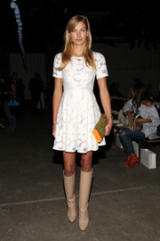 Jessica Hart was sweet and demure in a white lace dress during the Zimmermann fashion show.
