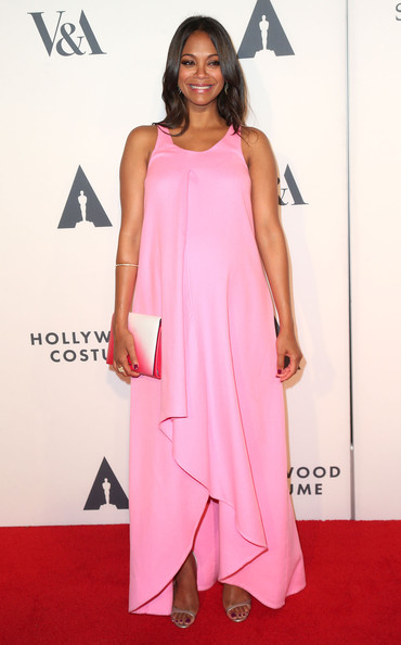 Zoe Saldana Maternity Dress [the academy of motion picture arts and sciences,dress,clothing,red carpet,shoulder,pink,carpet,fashion model,joint,cocktail dress,flooring,zoe saldana,wilshire may company building,california,los angeles,academy of motion picture arts and sciences,hollywood costume opening party - arrivals,hollywood costume opening party]
