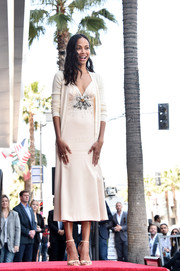 Zoe Saldana layered a cream-colored cardigan over a matching slip dress for her Walk of Fame Star ceremony.