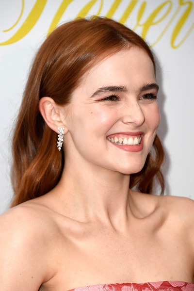 Zoey Deutch Dangling Diamond Earrings [hair,face,hairstyle,eyebrow,facial expression,lip,chin,skin,beauty,smile,arrivals,zoey deutch,flower,california,hollywood,arclight cinemas,the orchard,premiere,premiere]