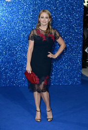 Christine Taylor kept it demure at the 'Zoolander No. 2' London fan screening in a navy sheath dress with a lace yoke and hem.