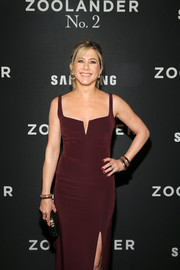 Jennifer Aniston complemented her burgundy dress with red mani.