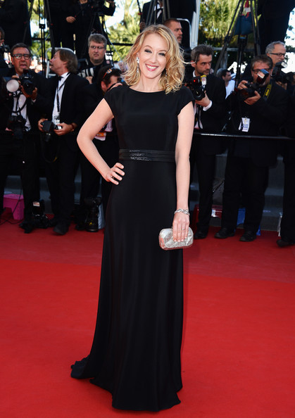 Ludivine Sagnier chose a column-style capped-sleeve gown with a black belt for her sleek and simple red carpet look.
