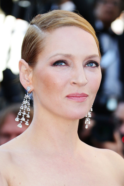 Uma Thurman's strawberry blonde locks were a thing of beauty when styled into this deep-side parted low bun.