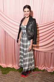 Mandy Moore layered a black leather jacket over her dress for some rocker edge.