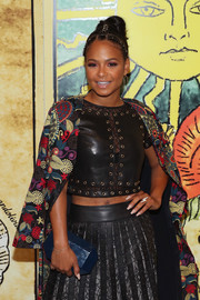 Christina Milian attended the Alice + Olivia fashion show carrying a faceted clutch.