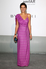 Margherita Missoni attended the Cinema Against AIDS Gala wearing an asymmetrical purple gown with drapey detailing.