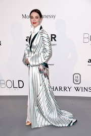 Ulyana Sergeenko covered up in glam style in a striped opera coat for the amfAR Cinema Against AIDS Gala.