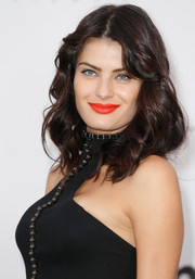 Isabeli Fontana looked youthful and pretty with her shoulder-length waves and center-parted bangs at the amfAR Cinema Against AIDS Gala.