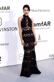 Shanina Shaik flashed plenty of flesh at the amfAR Cinema Against AIDS Gala in a black Philipp Plein gown rendered in alternating see-through lace and solid panels.