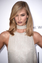 Karlie Kloss opted for a simple side-parted style when she attended the amfAR Cinema Against AIDS Gala.