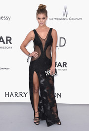 Nina Agdal turned up the heat at the amfAR Cinema Against AIDS Gala in a black gown with sheer cutouts and a hip-grazing slit.