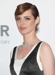 Louise Bourgoin attended the 2015 amfAR Cinema Against AIDS Gala. wearing a short side-parted 'do.