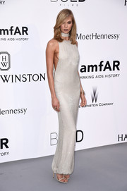 Karlie Kloss looked fierce in a side cleavage-revealing beaded column dress by Tom Ford at the amfAR Cinema Against AIDS Gala.