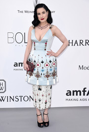 At the amfAR Cinema Against AIDS Gala, Dita Von Teese worked an exaggerated hourglass silhouette in this Ulyana Sergeenko Couture embroidered dress, featuring bell-shaped hips with a pencil skirt underlay.