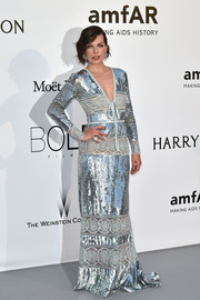 Milla Jovovich brought major shine to the amfAR Cinema Against AIDS Gala with this silver sequin gown by Elie Saab.