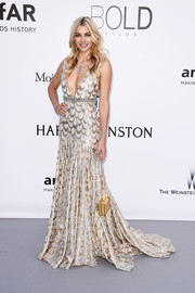 Jessica Hart attended the amfAR Cinema Against AIDS Gala wearing an alluring deep-V, scalloped fishtail gown by Miu Miu.