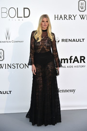 Lara Stone looked provocative in a sheer black lace gown by Givenchy Couture at the amfAR Cinema Against AIDS Gala.