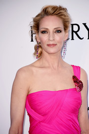 Uma Thurman was gorgeously coiffed with this loose side chignon at the amfAR Cinema Against AIDS Gala.