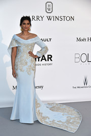 Sonam Kapoor looked like royalty in this asymmetrical pastel-blue Ralph & Russo off-the-shoulder gown with gold embroidery and a long train during the amfAR Cinema Against AIDS Gala.