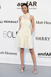 Liu Wen opted for this pale yellow flower-appliqued cocktail dress instead of a gown when she attended the amfAR Cinema Against AIDS Gala.