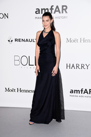 Bella Hadid went minimal in a draped black halter gown by Christian Dior Couture for the amfAR Cinema Against AIDS Gala.